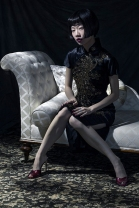 Image shows fashion loving Chinese Influencer and blogger, Harper Silin, at a photo-shoot styled and photographed by Pat Lyttle, with assistance of Rod Leon. Harper wears a vintage 1940s hand embroidered silk and sequin Cheongsam or Qipao, with high heel mules