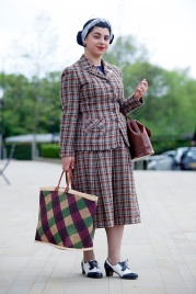 Wayne Hemingway's Classic Car Boot Sale at London's Kings Cross Peninsular, where vintage fashion and style, mix with entertainment and classic cars, for fans of preloved style. Image shows attendee Lucy Manley dressed in original 1940s Vintage style.
