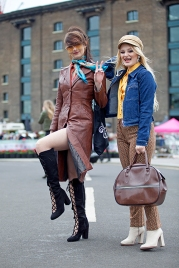 Wayne Hemingway's Classic Car Boot Sale at London's Kings Cross Peninsular, where vintage fashion and style, mix with entertainment and classic cars, for fans of preloved style. Image shows these two Go Go dancers dressed in 1960s Vintage style.