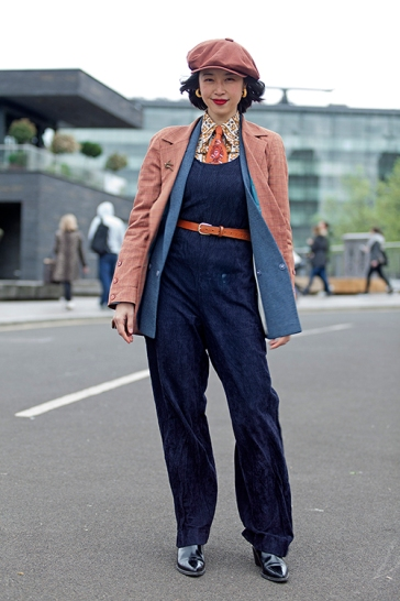Wayne Hemingway's Classic Car Boot Sale at London's Kings Cross Peninsular, where vintage fashion and style, mix with entertainment and classic cars, for fans of preloved style. Image shows attendees dressed in Vintage style.