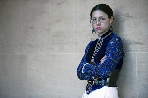 Manga artist Sonia Leong poses for a picture during a fashion shoot in Cambridge England. She wears a vintage Velvet Victorian jacket and vintage jodhpurs accented with a statement belt, styled and photographed by Pat Lyttle.