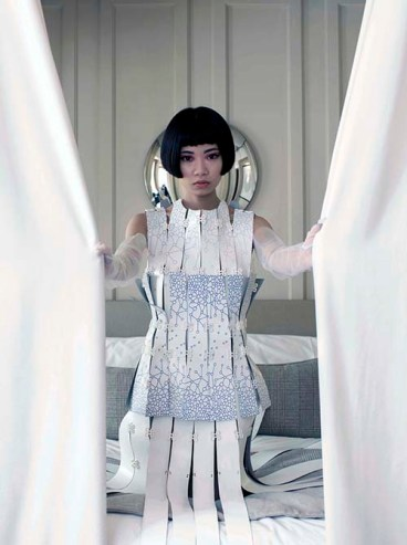 Image shows Chinese blogger and influencer Harper Silin, wearing a unique dress by sustainable designer Aurélie Fontan, with recycled leather and actually designed on and with collaboration with the Samsung Galaxy 9 mobile phone. Part of an editorial photo shoot, styled by Pat Lyttle.