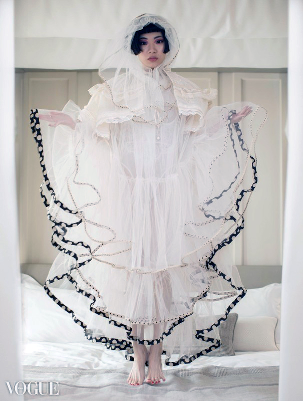 Image shows Chinese blogger and influencer Harper Silin, wearing a statement tulle hooded dress and cape by Missy Yue, part of an editorial shoot, styled by Pat Lyttle.