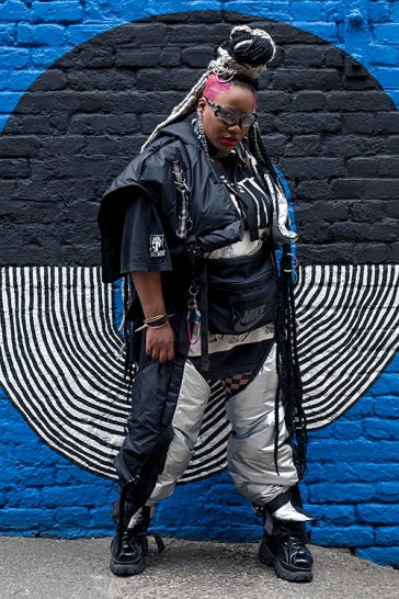 Street style on day 3 of London Fashion Week Mens on June 9th 2019. Image shows fashion designer Monzie Terri of Euqinom7Designs, wearing her own creation.