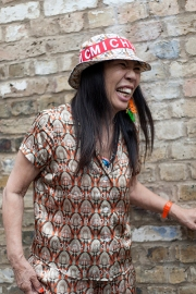 Street style on day 3 of London Fashion Week Mens SS 2020. Image shows Japanese fashion designer Mishiko Koshino laughing.