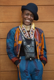 Street style shot on day two of Africa Fashion Week London 2019. Image shows super stylish personal stylist Yokai from Zimbabwe, dressed in a hat from her own collection, statement jewellery, trousers and jacket set by Ace Hackney.