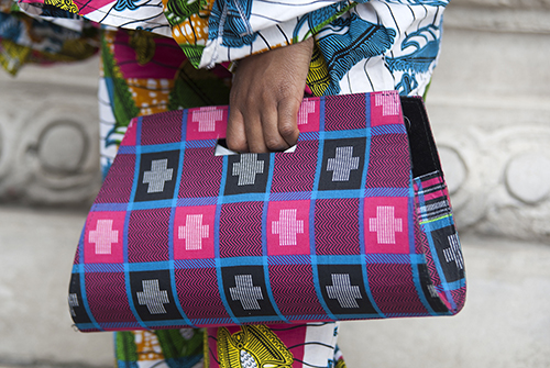 Street style shot on day two of Africa Fashion Week London 2019. Image shows a Dutch printed cotton handbag