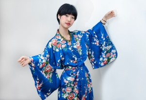 Two lovely young South Korean sisters on a visit to London, allowed me to style them for a day. Image shows Gabin Lee. She wears a blue printed satin Kimono style vintage robe robe