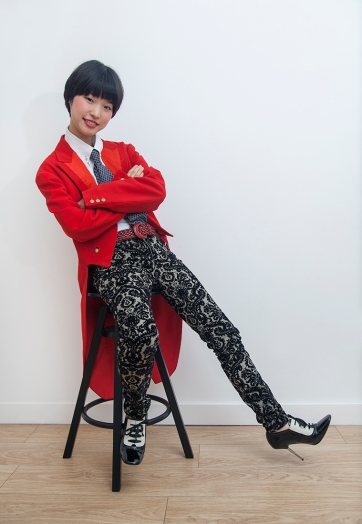 Two lovely young South Korean sisters on a visit to London, allowed me to style them for a day. Image shows Gabin Lee. She wears a dandy menswear look of a vintage 1950s red tail coat, a shirt and tie, trousers by Topshop and vintage monochrome heels, by Lanvin.