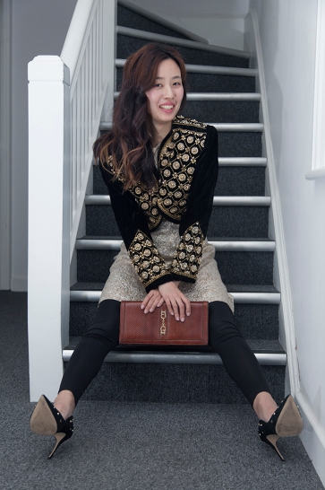 Two lovely young South Korean sisters on a visit to London, allowed me to style them for a day. Image shows Gayeon Lee. She wears a Spanish vintage matador style bolero jacket, over a 1960s lurex dress, with a snake skin clutch bag.