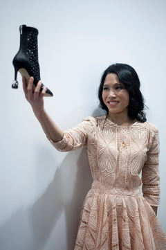 Fashion designer Melissa Chung shows off her stylish Krippit heel protectors, on the back of a high heel ankle boot. She exhibited her collection on day one of London Fashion Week at Canada House, in Trafalgar Square, on September 12th 2019.