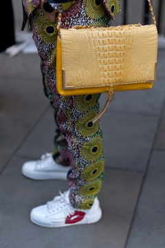 Street Style on day one of London Fashion Week SS 2020, outside Canada House in Trafalgar Square on Thursday September 12th 2019. Image shows Dipti from India. She wears a suite by an Indian designer with Dutch cotton fabric from Ghana, with a bag from Bebe and glasses by Miss Sixty.