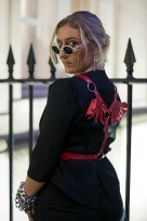 Street Style on day one of London Fashion Week SS 2020, outside Canada House in Trafalgar Square on Thursday September 12th 2019. Image shows Stylist Plum O'keeffe, wearing a vintage jacket by Alexander mcQueen with a red harness with wings, and chains on her wrists.