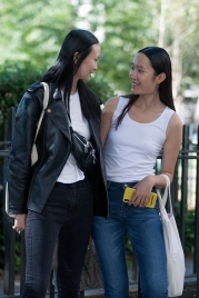 Street Style on day two of London Fashion Week SS 2020 on Friday September 13th 2019, showcasing stylish individuals London is internationally known for. Image shows two fashion models from China, after walking a show. On the right in the white vest is Amber Hu and on the left in the black biker jacket is Li Lin