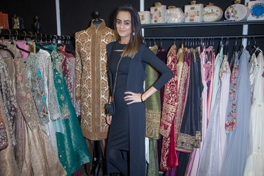 Images from The National Asian Wedding Show & India Fashion Week London at the Novotel in Hammersmith on Saturday 16th 2019, shot by Stylist Pat Lyttle. Image shows the designer of luxury brand IJAAZAT with some of her creations on display during the event.