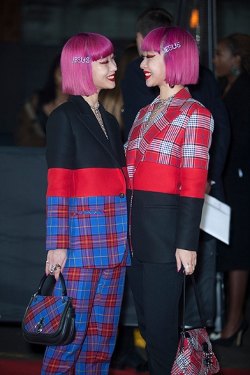"Red carper arrivals at ""The Fashion Awards 2019"", which took place at The Royal Albert Hall in London, on December 2nd 2019. Image shows Japanese fashion loving models and identical twins, Ami and Aya Suzuki both dressed in Vivienne Westwood."