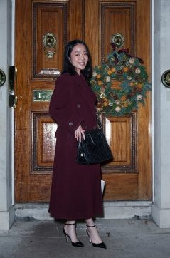 Guest's attending the Mulan Foundation Awards 2019 at the Oriental Club in London. Image shows Jacqueline Chan, wearing a Vintage red coat by Michel René, a dress by Elie Tahari, bag by Marc Jacobs and shoes by Tory Burch