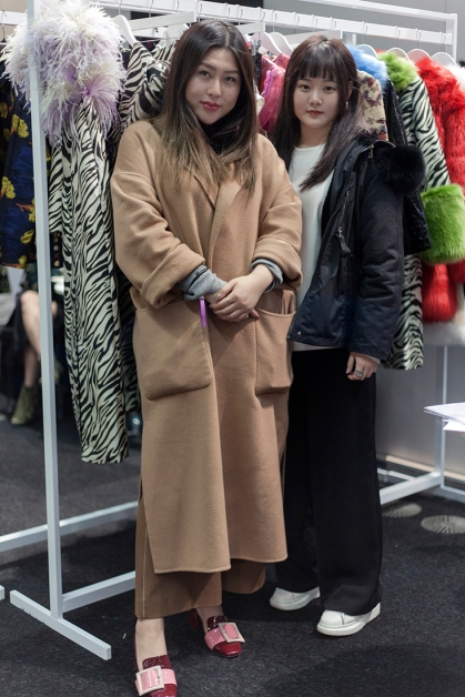 Images from SCOOP International Fashion Event on Feb 9th 2020, showcasing designers and brands for the AW 2020 season. Image shows Moira Niu of fashion PR brand Crescent Fashion, with her assistant.