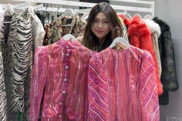 Images from SCOOP International Fashion Event on Feb 9th 2020, showcasing designers and brands for the AW 2020 season. Image shows Moira Niu of fashion PR brand Crescent Fashion, with two pieces of from the Rue Agthonis collection.