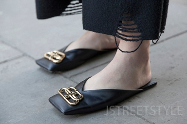 Street style in London January 2020. Image shows student Cheng Hu from China, and her sandals or slides by Balenciaga.