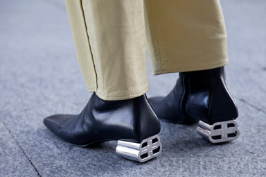 Street style in London January 2020. Image shows a pair of statement heel leather shoes by Balenciaga.
