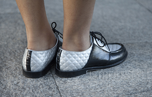 Street style in London January 2020. Image shows Business and Social Media student Xīng Zhēn Ji, or Amy from China and her shoes by Chanel.