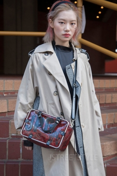 Street style in London on Sunday 8th March 2020. Fans of vintage style showcase their individuality. Image shows Jia from China, She wears a jacket by Chinese brand EEE with a bag by Jean Paul Gaultier.